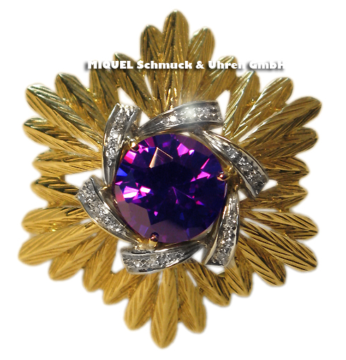 Gold brooch with purple stone and diamonds